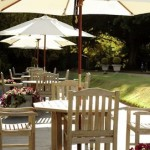 The outdoor terrace with parasols make for a lovely venue for an alfresco afternoon tea at Alexander House, West Sussex.