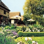 The beautiful gardens at Langshott Manor Hotel, Surrey, the perfect venue for an outdoor afternoon tea