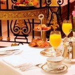 A traditional afternoon tea with orange juice at Peridot at the Bentley, London in Kensington and Chelsea