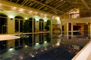 Spa and Afternoon Tea Stapleford Park Country House Hotel, The Midlands. The beautiful swimming pool gently lit at night.