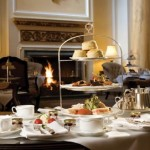 A roaring log fire and table set for afternoon tea at the Grand Hotel, Eastbourne in East Sussex.