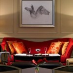 A beautiful red contemporary sofa at Grosvenor House, makes for a relaxing spot for afternoon tea in London's Mayfair.