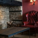 A beautiful leather arm chair and snug in the Slaughters Country Inn, Gloucester, the ideal spot for afternoon tea.