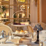 A decadent three tiered cake stand served for afternoon tea at the Ritz, London.