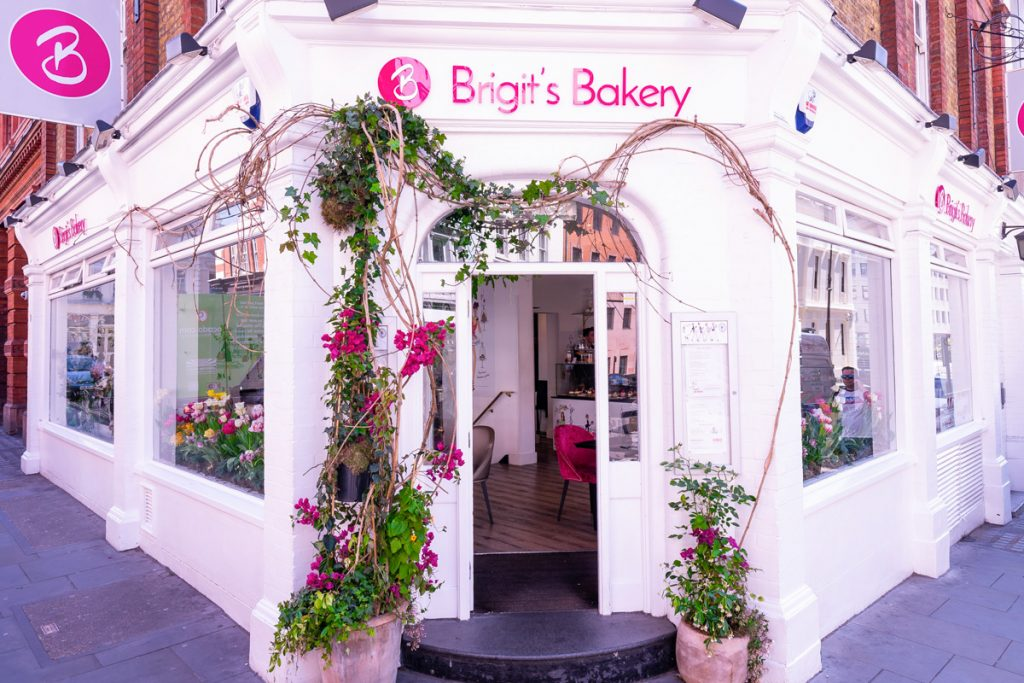 The colourful entrance swathed in bright flowers to Brigits Baker, Covent Garden