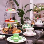 A decadent afternoon tea at Brigits Bakery with beautiful foilage decorated crockery
