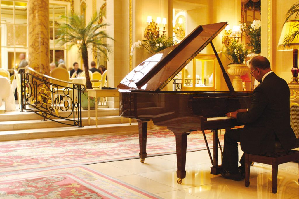 Enjoy afternoon tea at the Ritz accompanied by their resident pianist.