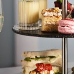 Traditional afternoon tea at Hopetoun House with sandwiches, macarons and home made scones in West Lothian