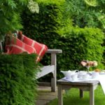 Enjoy afternoon tea in the gardens at Cotswolds House, Chipping Camden, Gloucestershire.