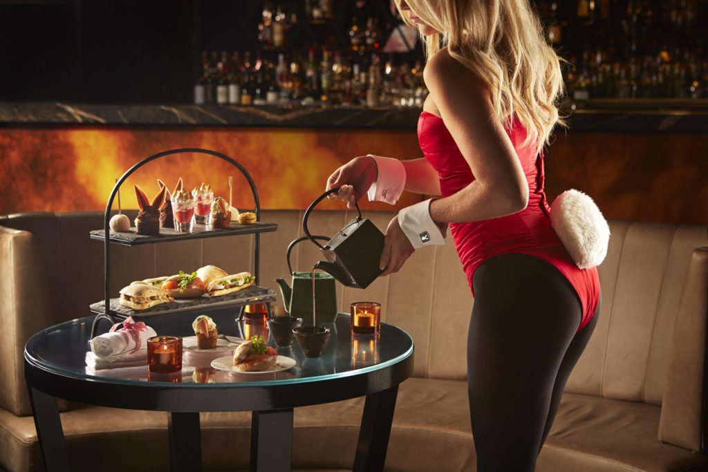 An iconic bunny girl serving afternoon tea at the Playboy Club, Mayfair.