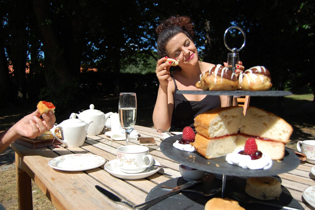 Enjoy an alfresco afternoon tea at Grove Hotel in the beautiful gardens.