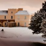 Pentillie Castle surrounded by snow. A beautiful venue in Cornwall for afternoon tea.