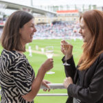 Enjoying a glass of champagne at the Kia Oval Cricket Ground, London.