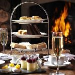 Afternoon tea in front of a roaring log fire