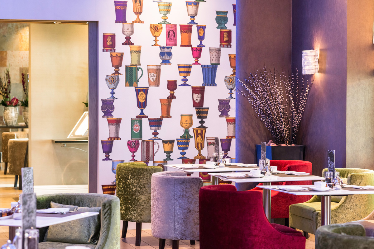 Enjoy afternoon tea at Hotel Xenia Autograph Collection in their stylish and colourful lounge
