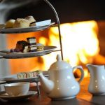 Afternoon tea at Thornbury Castle, Bristol in front of a beautiful, welcoming log fire.