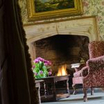 Enjoy afternoon tea at Thornbury Castle, Bristol in front of a roaring fire in a sumptuous armchair