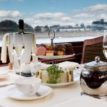 Windsor Afternoon Tea Cruise on board Bateaux London's Willow Room, a glass boat.