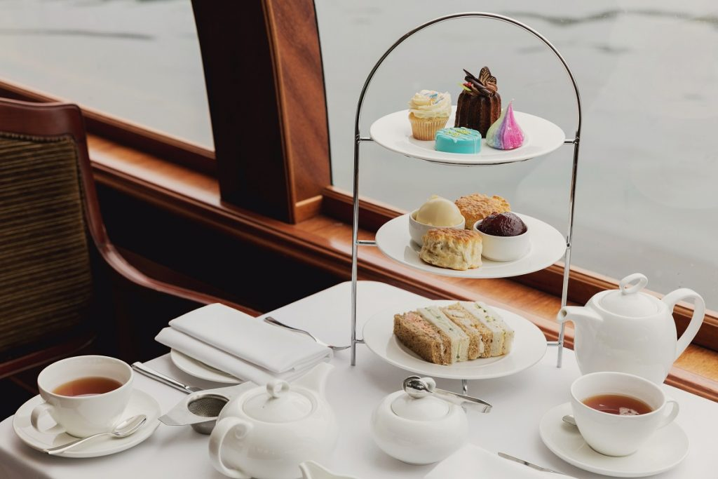 Enjoy a Windsor Boat Trip with Afternoon Tea on board a glass boat with Bateaux London's Willow room